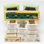 Bachmann HO-gauge Electric Trains Series boxed carriages and rolling stock.