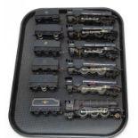 Six 00-gauge unboxed locomotives and tenders.
