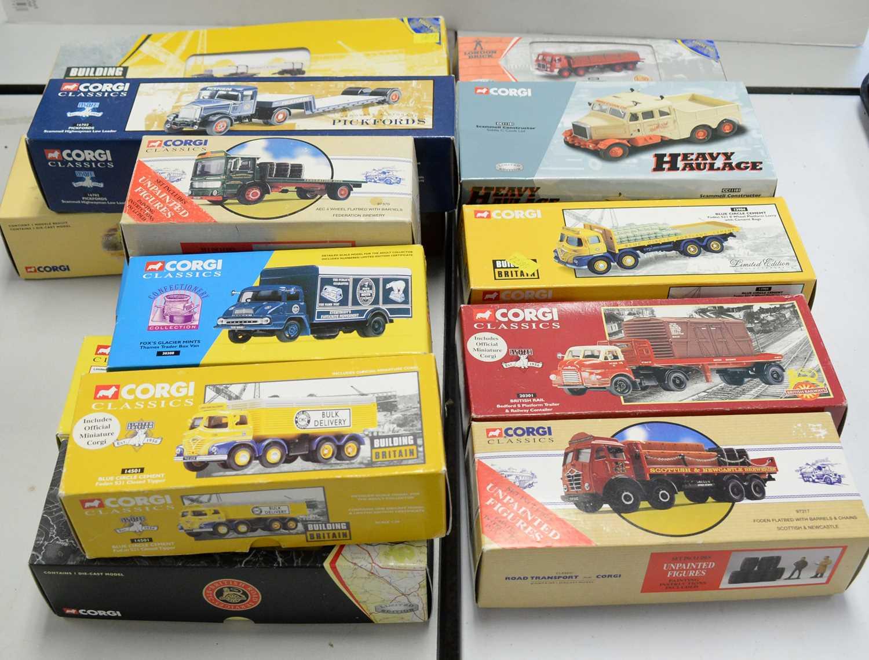 Boxed Corgi scale model vehicles.