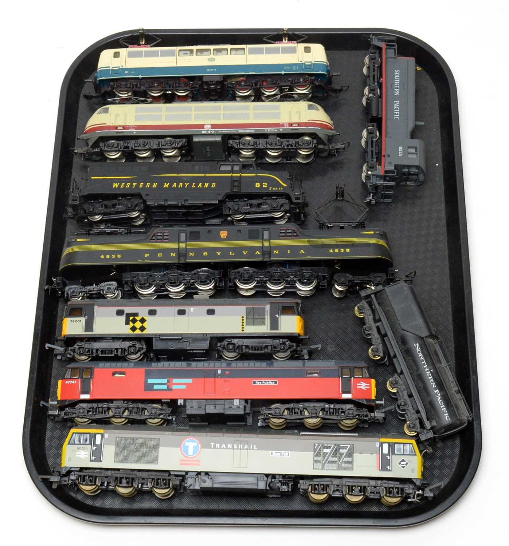 Eight 00/HO-gauge unboxed trains and tenders.