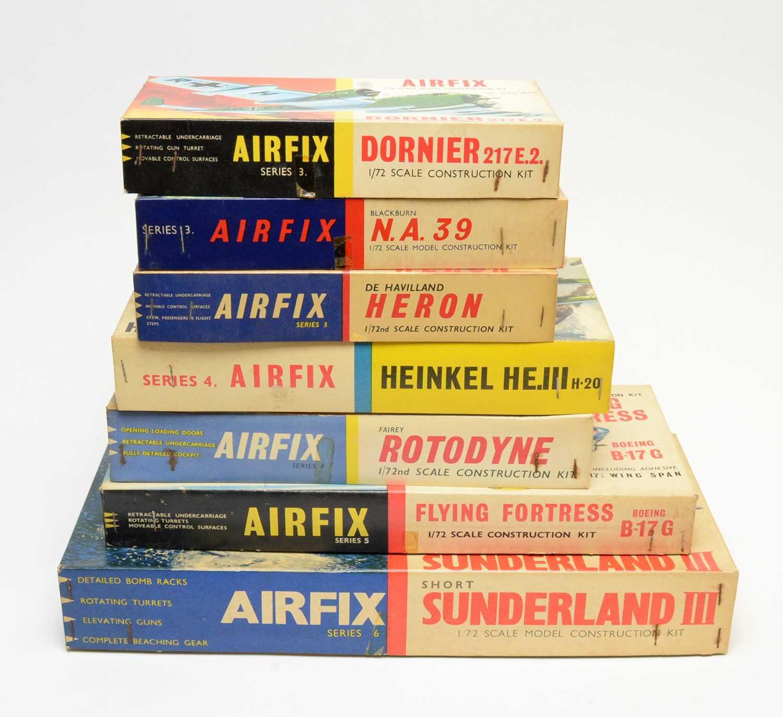 Seven boxed Airfix model construction kits.