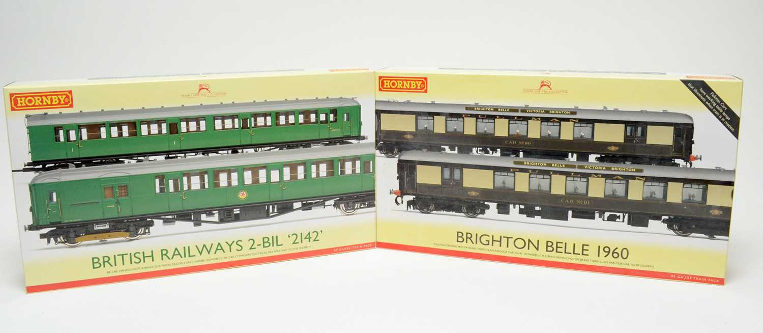 Two boxed Hornby train packs.