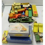 Boxed and unboxed Dinky scale model vehicles.