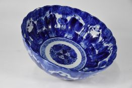 A 19th century Japanese blue and white floriform punch bowl