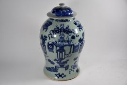A Chinese blue and white celadon ground 'Hundred Antiques' pattern jar and cover