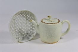 An 18th century Chinese porcelain white glazed teapot to/w reticulated domed cover (2)