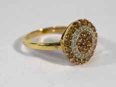 A Continental two coloured diamond ring