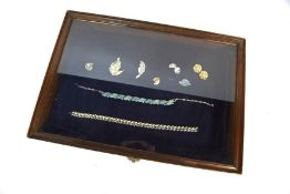 A display case containing vintage designer costume jewellery