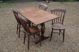 A refectory style dining table and four chairs