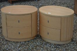 A pair of 'Dwell' modern ovoid two drawers bedside chests
