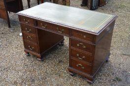 A mahogany twin pedestal desk