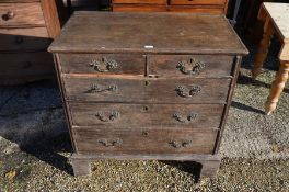 An antique oak chest or two short over three long graduating drawers