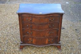 A mahogany serpentine front chest of drawers