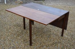 A 19th century mahogany drop leaf dining table