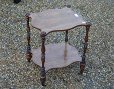 A Victorian rosewood and mahogany two-tier table