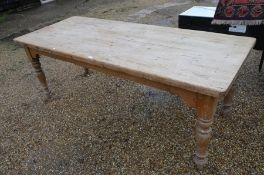 An old pine farmhouse kitchen dining table
