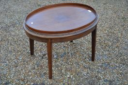 A mahogany oval tray-top butlers table