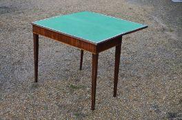 A Victorian mahogany card table