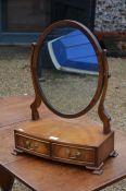 An Edwardian mahogany framed oval toilet mirror
