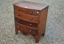A small 19th century mahogany bowfront chest of four drawers