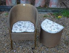 A Lloyd Loom 'Lusty' wicker chair to/w matching laundry basket (2)