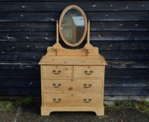 A pine mirror backed dressing chest