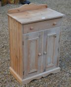A stripped pine bedroom cabinet