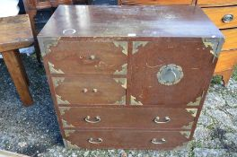 A Japanese stained hardwood and brass mounted cabinet