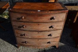 A 19th century mahogany chest of four long graduating drawers
