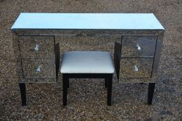A contemporary mirrored dressing table and stool