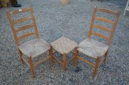 A pair of provincial pine rush seated ladder back chairs to/w a rush-woven stool
