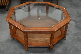 An octagonal glass top coffee table