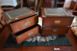 A pair of mahogany and brass mounted campaign style bedside chests