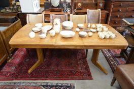 An oak extending dining table