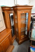 A pair of teak glazed display cabinets