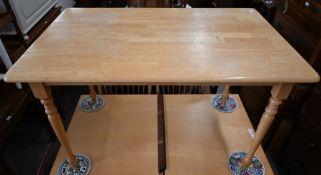 A modern beech kitchen dining table