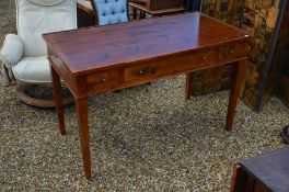 A modern stained hardwood dressing table with three drawers