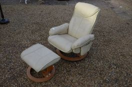 A cream leatherette Stressless style reclining armchair and stool (2)