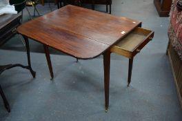 A 19th century mahogany Pembroke table