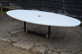 A modern white laminate/melamine oval boardroom table