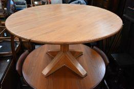 A bespoke circular pitch-pine dining table