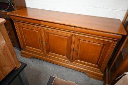 A large teak sideboard
