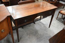 A late Victorian mahogany writing table