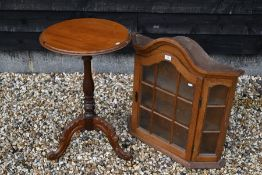 A small oak wall hanging display cabinet