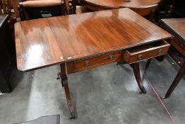 A Regency style mahogany and ebony strung sofa table
