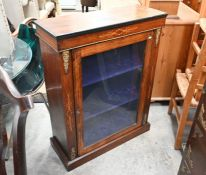 A Victorian walnut and satin inlaid pier cabinet