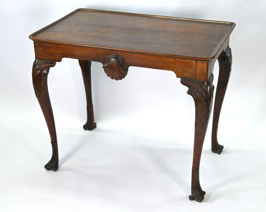 A George III mahogany shell carved silver table of Irish origin
