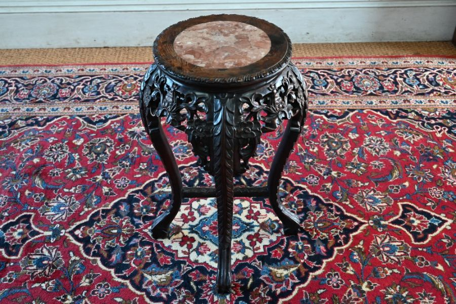 An antique Chinese carved rosewood stand - Image 2 of 3