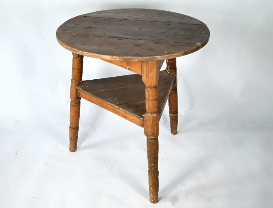 A 19th century stripped pine cricket table