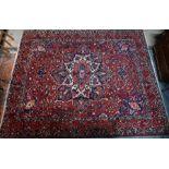 An old Persian Bakhtiari carpet, 410 cm x 330 cm